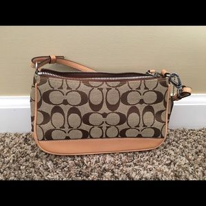 Tan and brown signature w/leather trim authentic